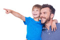 What is there side view of happy father and son looking away while child pointing away and both standing isolated on white Stock Photo