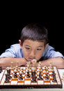What will be my next move a young boy is deep in thought concentrating on his would Royalty Free Stock Photo