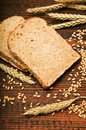 Wheat bread and grain ears Stock Photos