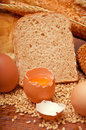 Wheat bread, grain and ears with eggs Royalty Free Stock Photo