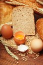 Wheat bread, grain and ears with eggs Royalty Free Stock Image