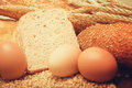 Wheat bread, grain and ears with eggs Royalty Free Stock Photos