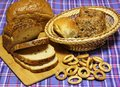 Wheat bread products are on blue tartan Royalty Free Stock Photo
