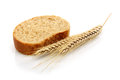 Wheat bread and wheat a shock of on a white background Stock Photos