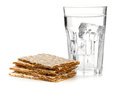 Wheat crispbread slices and glass of water stacked with over white background dieting concept Royalty Free Stock Photo