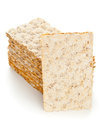 Wheat crispbread slices multiple of over white background Royalty Free Stock Photo