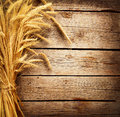 Wheat ears on the wooden table harvest concept Stock Photos