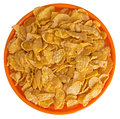 Wheat flakes in orange bowl white background Royalty Free Stock Photo