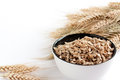 Wheat flakes and wheat spikelets Stock Photo
