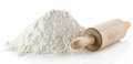 Wheat flour heap of and rolling pin on white background Royalty Free Stock Photography