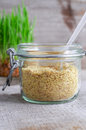 Wheat germ in a glass jar Royalty Free Stock Photo