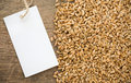 Wheat grain and tag price Royalty Free Stock Photo