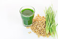 Wheat grass juice on white background with fresh and Stock Photos