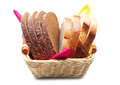 Wheat and rye bread in a basket on white background Stock Image