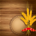 Wheat on wooden background spikelets of the Royalty Free Stock Images