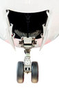 The wheel of airplane landing from front on white background Stock Photo
