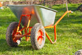 Wheel barrow on the grass Royalty Free Stock Photo