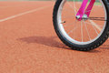 A wheel of bike on the runway Stock Photo
