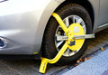Wheel clamp tire on a car parked illegal no parking zone Stock Photography
