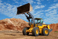 Wheel loader bulldozer in sandpit Royalty Free Stock Photo