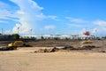 Wheel loader Excavator loading soil at eathmoving works Royalty Free Stock Photo