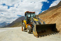 Wheel loader excavator at mountains work machine doing ready to earthmoving roadwork india Stock Photo