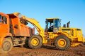 Wheel loader excavator and tipper Royalty Free Stock Image