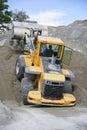 Wheel loader Excavator unloading sand Royalty Free Stock Photo