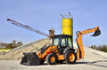 Wheel loader excavator unloading sand of construction site concrete plant Royalty Free Stock Images