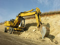 Wheel loader machine works in construction site Stock Image
