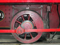Wheel of an old steam locomotive painted red Royalty Free Stock Photo