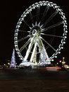 Wheel in slow motion white illuminated at night amusement park of concordes place paris france Stock Photography