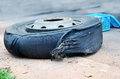 Wheel tire of bus broken and explosion on the road Royalty Free Stock Photo