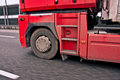 Wheel truck in motion a view of front side of red with a speeding driving on highway Royalty Free Stock Photos