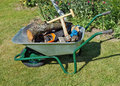 The wheelbarrow is on a garden lawn Royalty Free Stock Photo