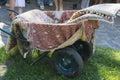 Wheelbarrow on the lawn Royalty Free Stock Photo
