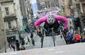 Wheelchair athlete competing in a road race in glasgow Royalty Free Stock Photos