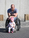 Wheelchair Dad and Daughter Stock Images