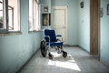 Wheelchair in hospital abandoned an old Royalty Free Stock Image