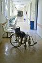 Wheelchair at hospital in empty waiting room of Stock Photos