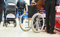 Wheelchair invalid in shop Royalty Free Stock Photo