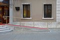 Wheelchair ramp with red carpet for easy access in building Stock Photo