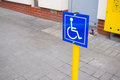 Wheelchair sign blue showing parking spot for disabled people Royalty Free Stock Images