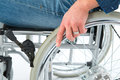 Wheelchair user hand on the wheel one Royalty Free Stock Images