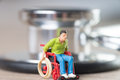 Wheelchair user man in a and stethoscope Royalty Free Stock Photos