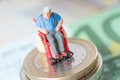 Wheelchair user old man in a with money Stock Image