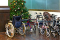 Wheelchair for a xmas tree and walking carts Royalty Free Stock Photography