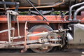 Wheels of historic steam train close up view drive unit with push rods Royalty Free Stock Photo