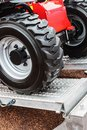Wheels of the tractor drive onto Royalty Free Stock Photo