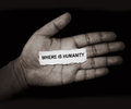 Where is humanity the words in paper on hand Stock Photos